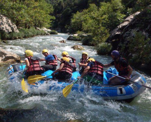 people rafting river